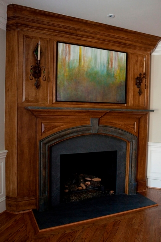 The After – The artwork includes the faux bois and stone on the fireplace as well as the custom painting