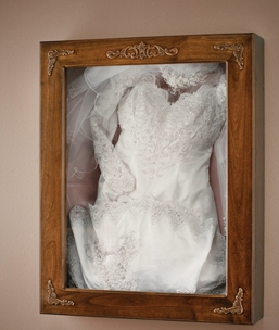 A framed wedding dress makes for a great gift idea!